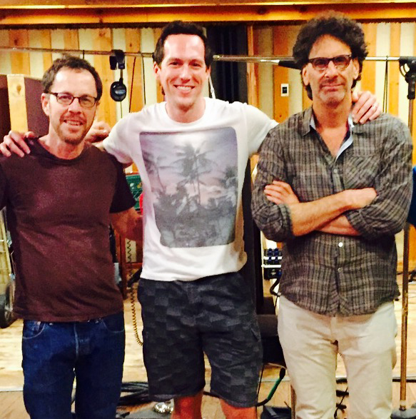 On HAIL, CAESAR! set with directors, Joel and Ethan Coen.